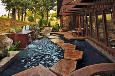 如何设计庭院锦鲤鱼池建造效果图